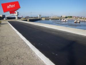 港内道路修繕工事 完成(道路が全体的に沈下し擁壁と段差が生じていたので、オーバレイ舗装を行いました。)